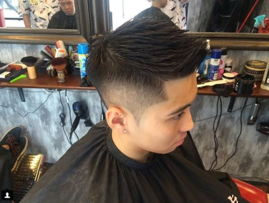 Mid Fade with Short Faux Hawk Haircut