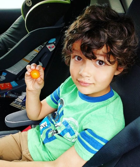Whimsy and Classic Curly Hairstyle For Boys