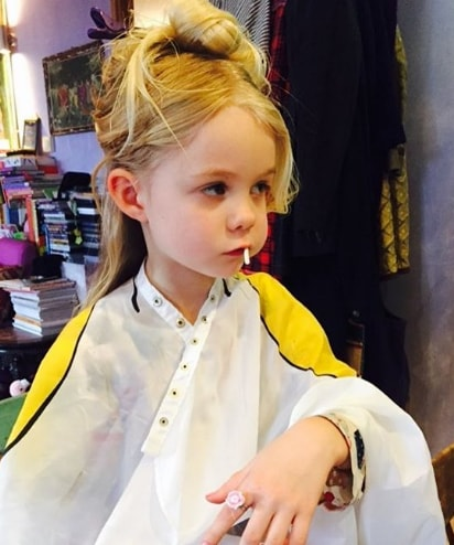 Little Girl with Stylish Bun