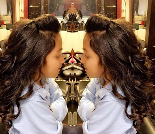 Pompadour with Long Wavy Girls Haircut