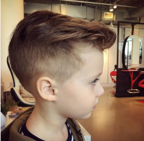 Medium Length Side Swept Hair With High Fade