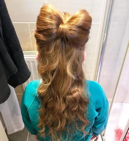 elegant bun with long wavy girl hairstyle