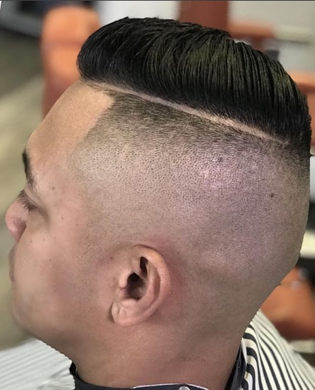 Slicked Back Hair With Hard Parted Undercut