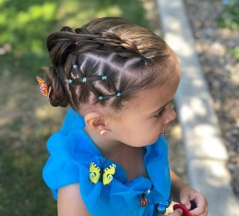 Braided Hairstyle With A Bun At The Back