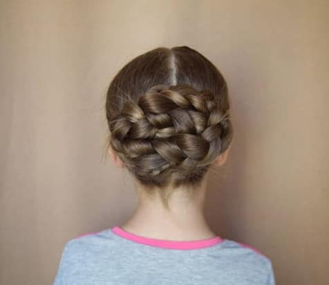 Center Parted Hairstyle With Braided Bun
