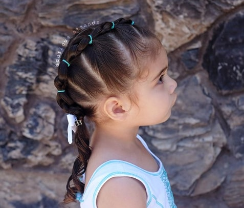 Center Parted Hairstyle With Unique Braided Ponytail