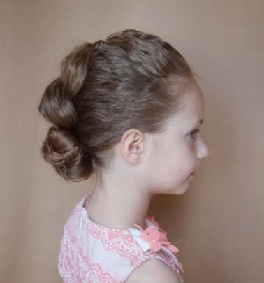 Combed Back Hair With Twisted Bun
