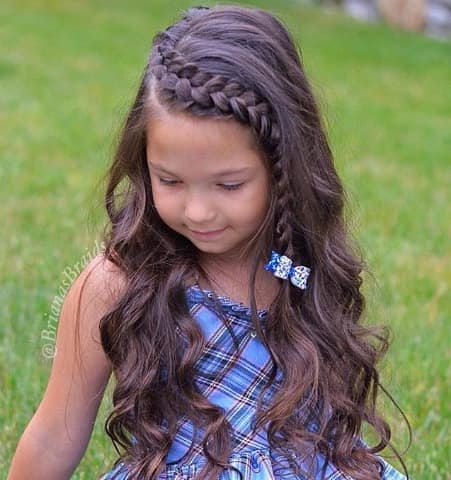 Long And Wavy Hairstyle With A Braided Fringe