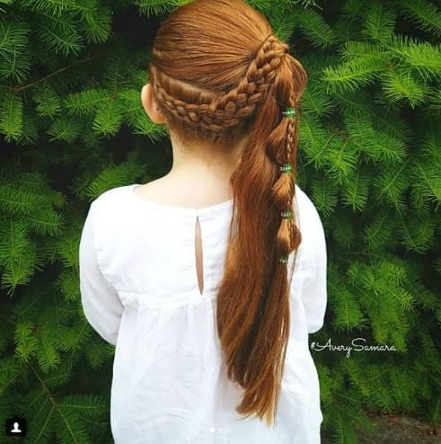 Thick Braid With A Long Ponytail On A Side