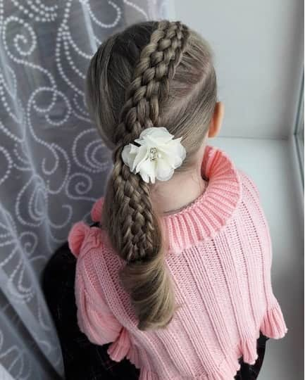 Thick Centred Braid With A Combed Back Look