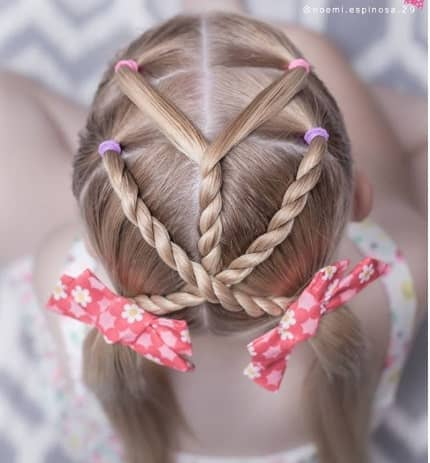 Centre Parted Hairstyle With Braided Design