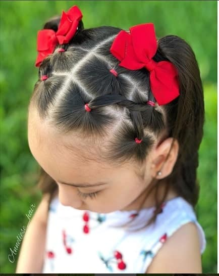 Centre Parted Hairstyle With Pigtails