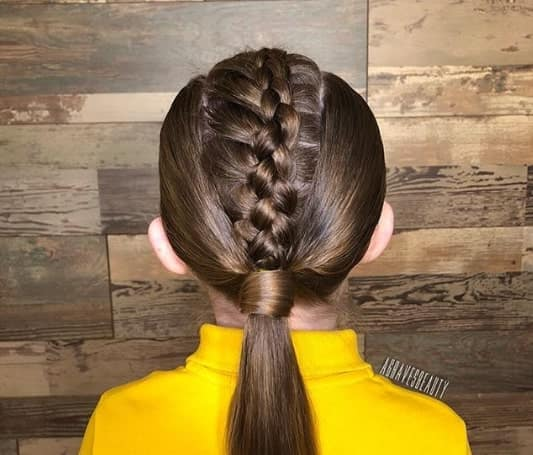 Combed Back Look With A Centred Braided Ponytail