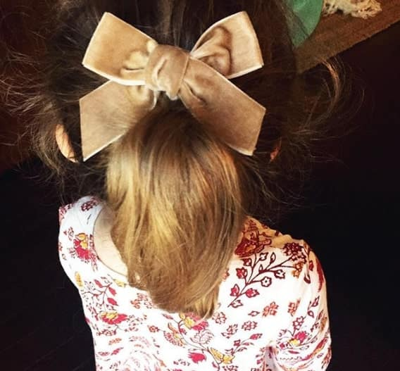Long Ponytail With A Statement Bow On Top