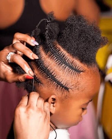 Cornrows Hairstyle With Top Knot And Ponytail