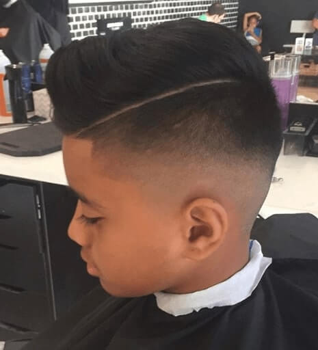 Side Swept Quiff With Hard Part And High Fade