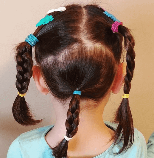 Center Parted Hairstyle With Braided Pigtails And Ponytail