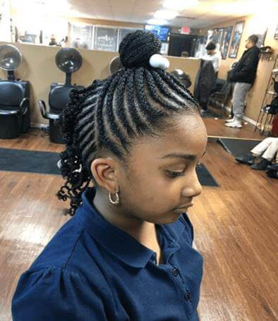 Swirling Cornrows With Top Bun And Ponytail