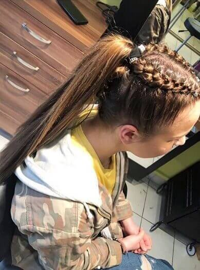 Center Parted Hairstyle With Parallel Braids And Long Ponytail