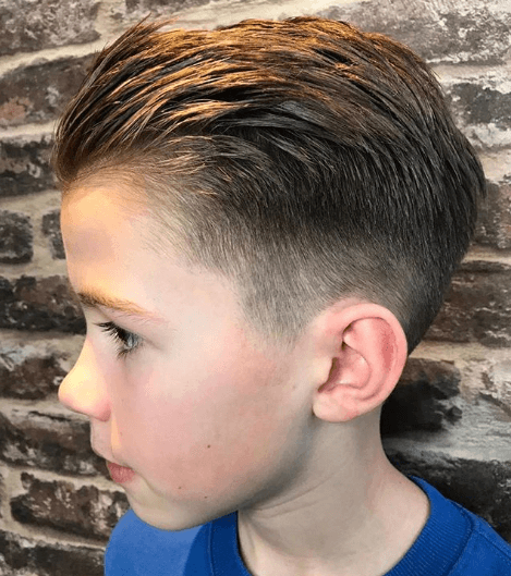 Textured Combed Back Hairstyle With Mid Fade