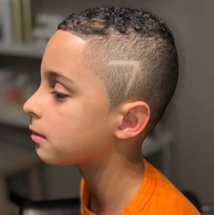 Short And Curly Hairstyle With Fade