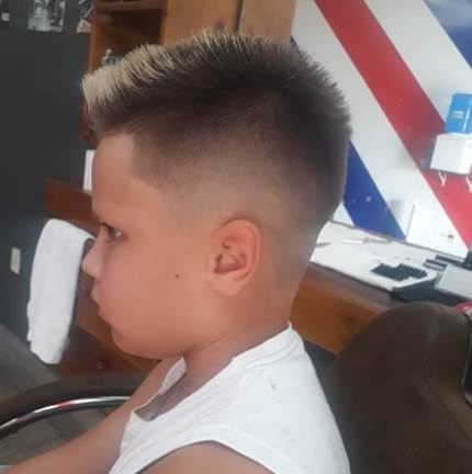 Textured And Edgy Side Swept Hairstyle With High Fade