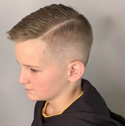 Textured Side Swept Hairstyle With High Fade