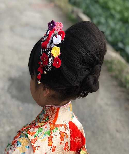 Asian Hairstyle With Typical Hair Bun