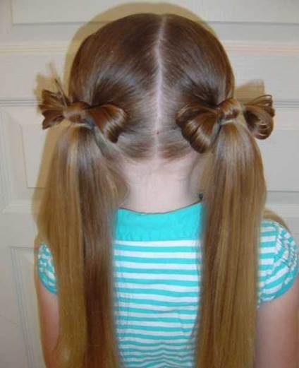 Center Parted Hairstyle With Bow Pigtails