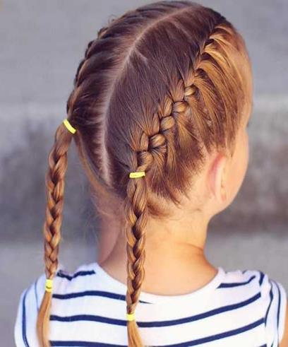 Center Parted Hairstyle With Braided Tails