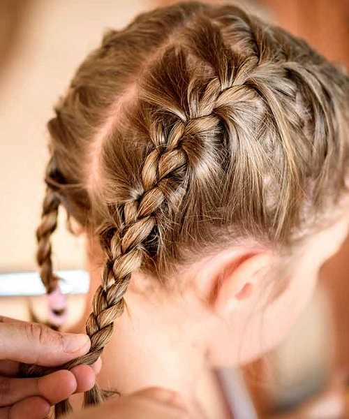 Center Parted Hairstyle With French Braided Tails