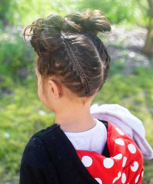Center Parted Hairstyle With Shape Up And Messy Hair Buns