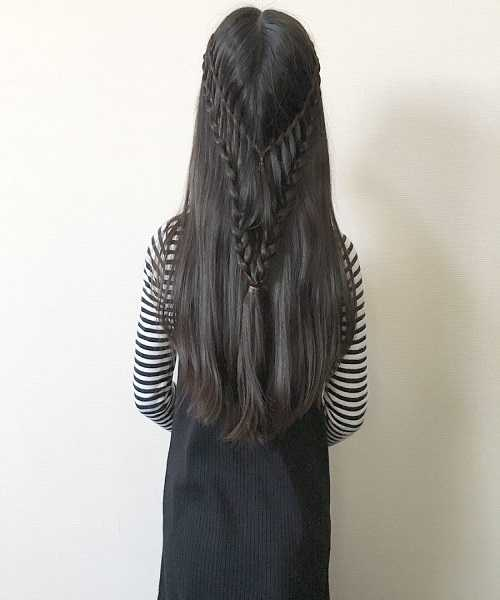 Center Parted Long Hairstyle With Braided Design