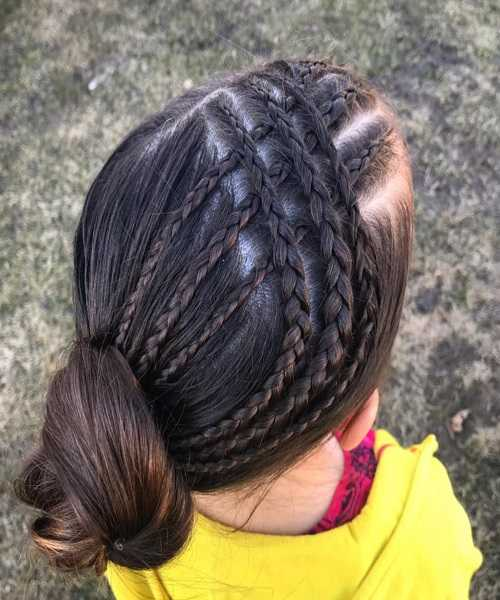 Combed Back Hairstyle With Braided Design And Bun