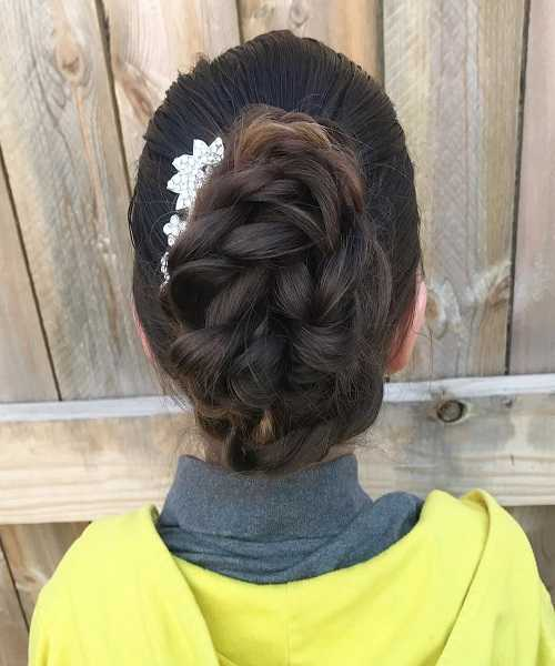 Combed Back Hairstyle With Loose Braided Voluminous Bun