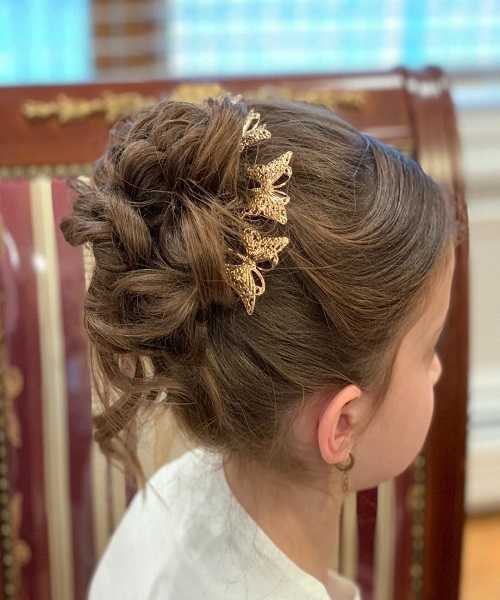 Combed Back Hairstyle With Messy Bun
