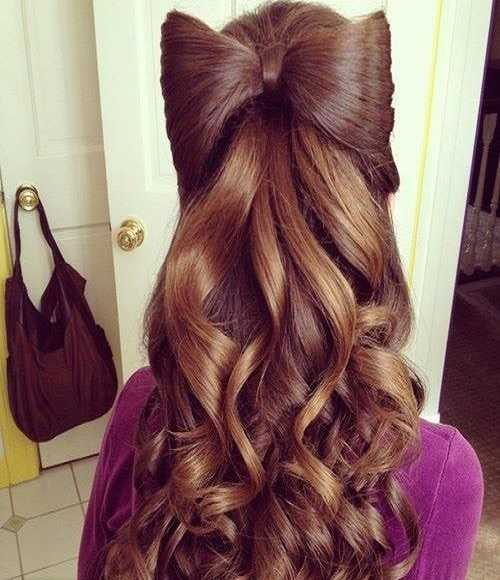 Combed Back Hairstyle With Statement Bow And Wavy Back
