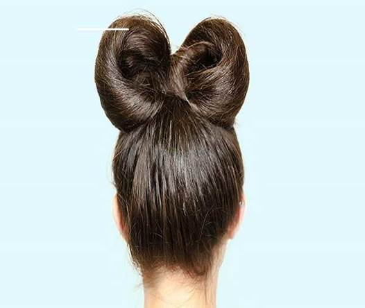 Combed Back Hairstyle With Stylish Hair Bow