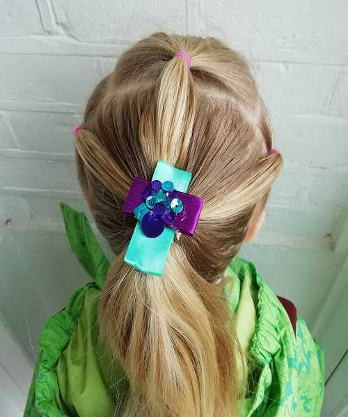 Combed Back Hairstyle With Voluminous Ponytail