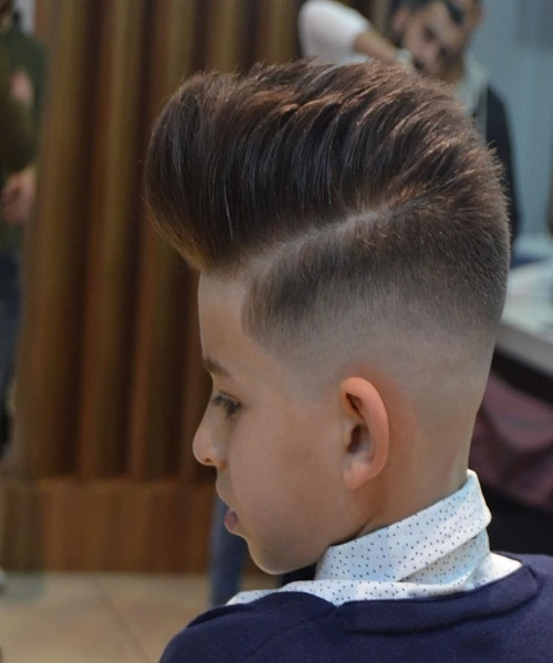 Edgy Combed Over Quiff With High Fade