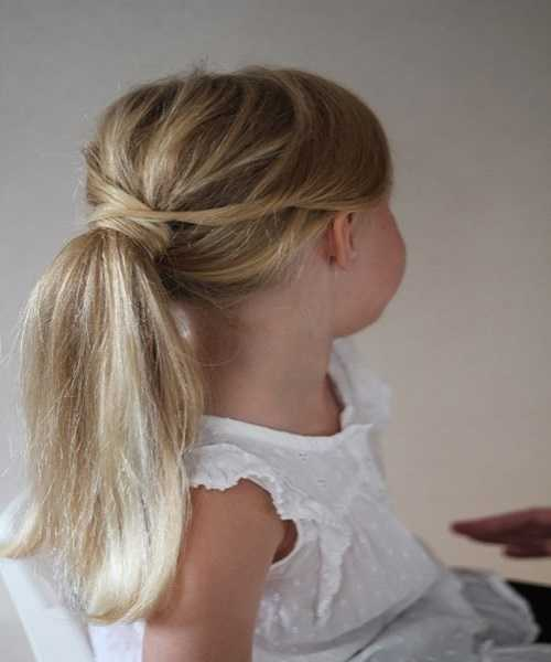 Loosely Textured Combed Back Ponytail Hairstyle