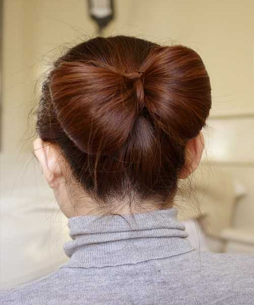 Tight Combed Back Hairstyle With Big Bow