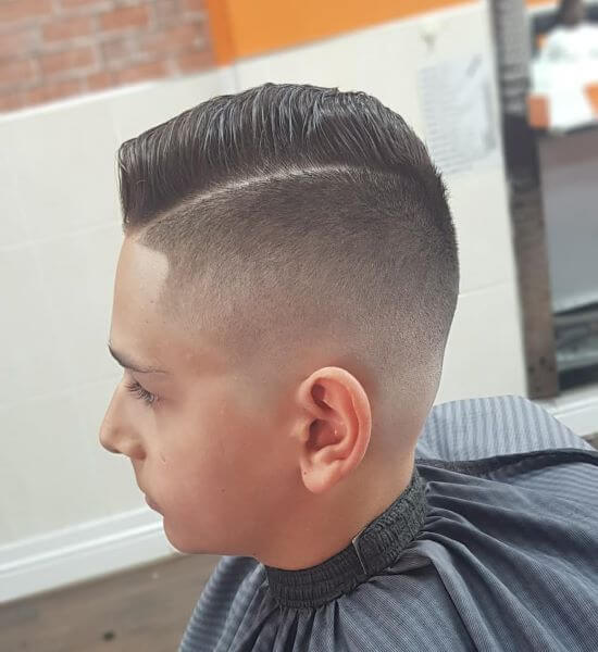 Comb Over Hairstyle With Skin Fade And Hard Part