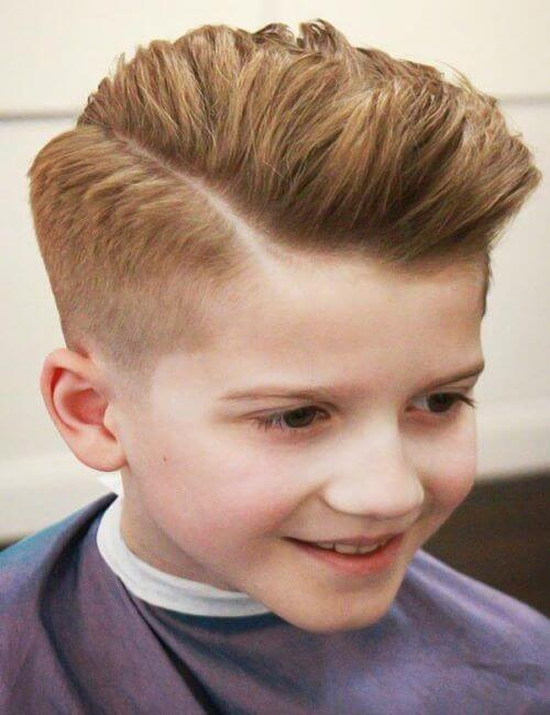 Angled Brushed Back Hairstyle With A High Fade