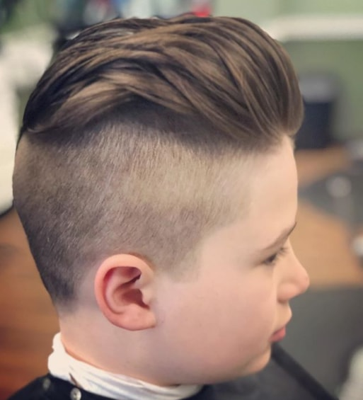 Slicked Back Hairstyle With A Mid Fade