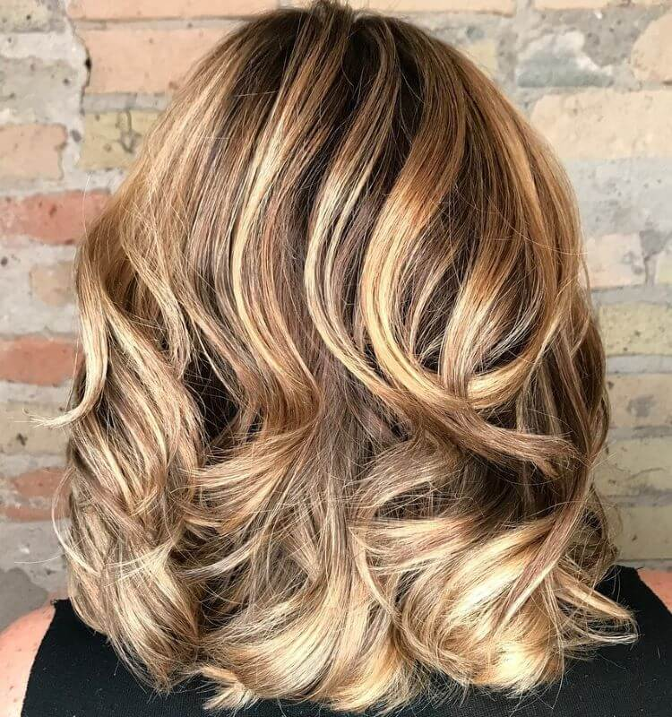 Layered And Wavy Shoulder-Length Hairstyle