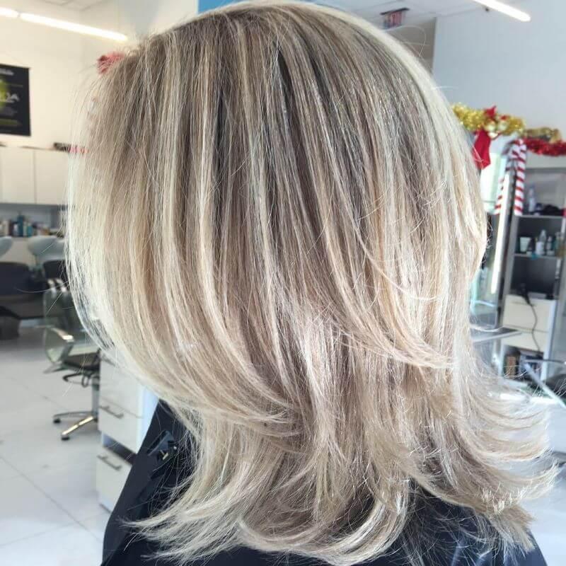Layered Blonde Medium Length Hairstyle