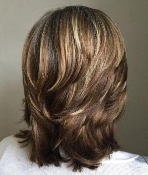 Medium Length Haircut With Short And Choppy Layers